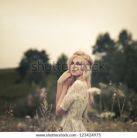 beautiful blonde in a summer field - stock photo