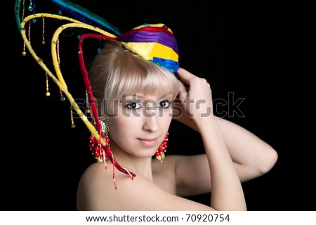 beautiful blonde in an extravagant hat - stock photo