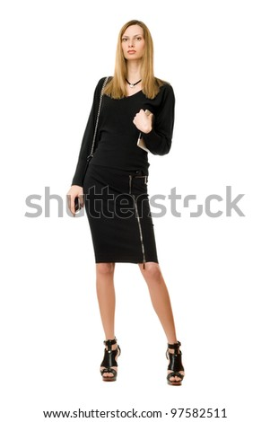 Beautiful blonde in black with the purse - stock photo