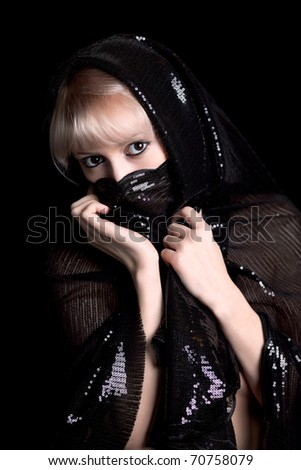 beautiful blonde in shiny black cape, his face covered - stock photo