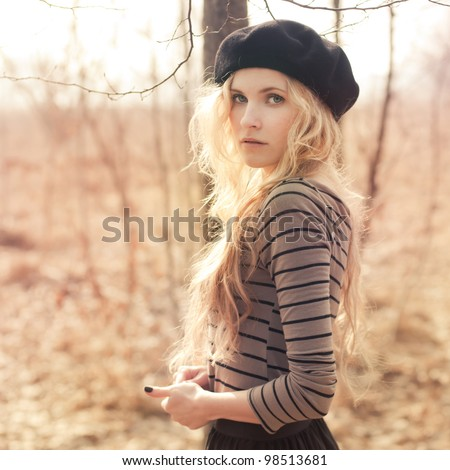 beautiful blonde in the park in the Hat - stock photo