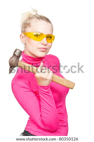 Beautiful blonde in the yellow glasses and a hammer in his hand. Isolated on a white background.