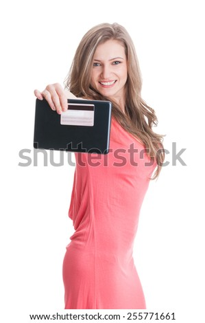 Beautiful blonde lady showing a tablet and credit or debit card to the camera