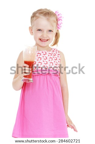 Beautiful blonde little girl holding a glass of tomato juice- isolated on white background - stock photo