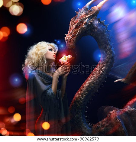 beautiful blonde looking on fantasy dragon as symbol for year 2012