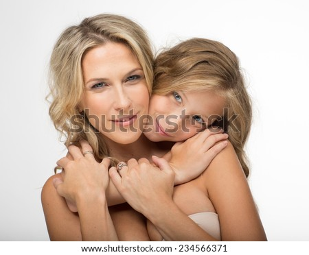 Beautiful blonde mother and her daughter together - stock photo