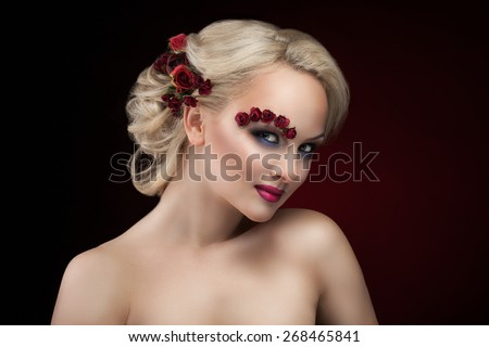 beautiful blonde on a dark background and with the eyebrow of roses