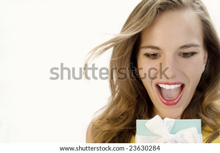 Beautiful Blonde Overjoyed by her Surprise Gift. - stock photo