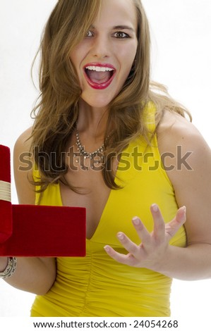Beautiful Blonde Overjoyed by her Surprise Gift.