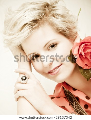 Beautiful blonde posing for the camera. - stock photo
