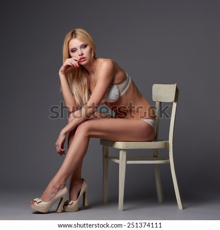 beautiful blonde sexy girl studio shot - stock photo