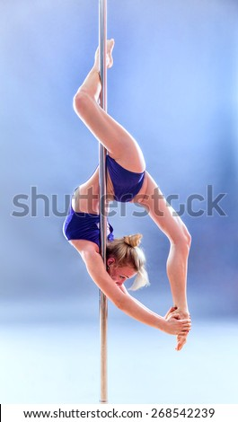 Beautiful blonde sexy pole dance woman. - stock photo