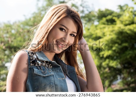 Beautiful Blonde Thai Asian Model Poses in Outdoor Natural Setting - stock photo