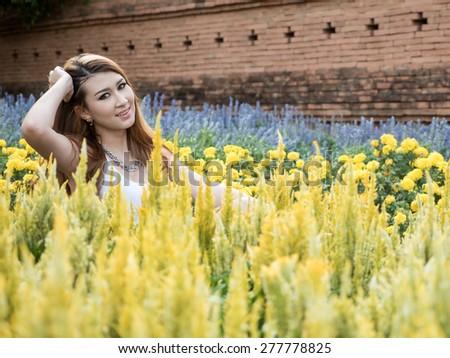 Beautiful Blonde Thai Asian Model Poses in Outdoor Natural Setting - stock photo