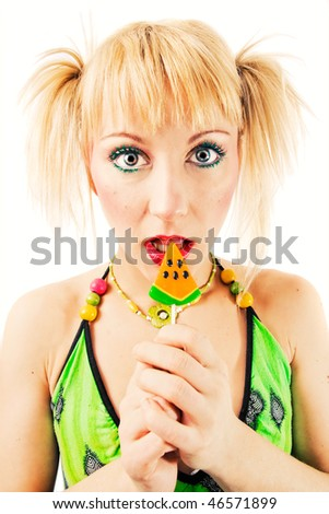 Beautiful blonde with a lollipop - stock photo
