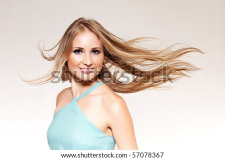 beautiful blonde with developing hair - stock photo