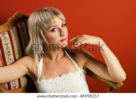 Beautiful blonde with green eyes looking at the camera - stock photo
