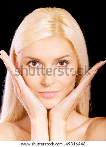 Beautiful blonde with palms at face, isolated on black background.