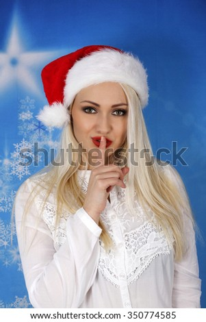 Beautiful blonde with red santa hat. - stock photo