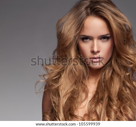 Beautiful blonde woman - stock photo