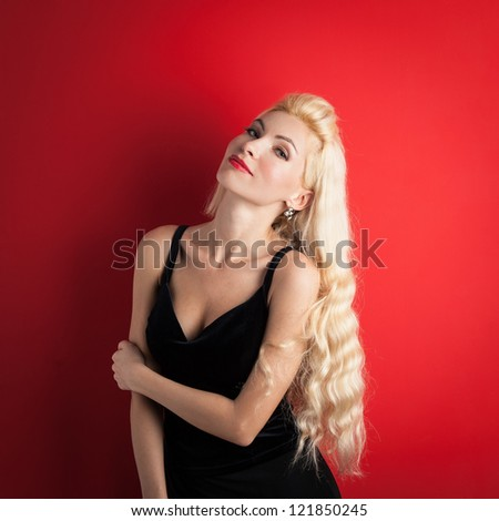 Beautiful blonde woman close up portrait against red background. - stock photo