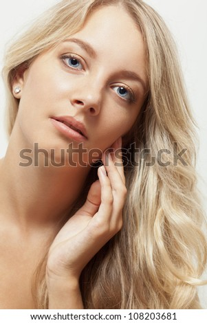 beautiful blonde woman closeup face portrait - stock photo