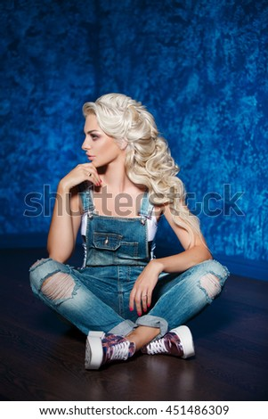 Beautiful blonde woman hipster in jeans denim, fashion model girl closeup, Portrait of beautiful woman, Sexy strict female in studio. Funny Hipster Girl. Fashion photo, series - stock photo