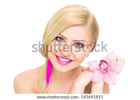 Beautiful blonde woman holding pink orchid