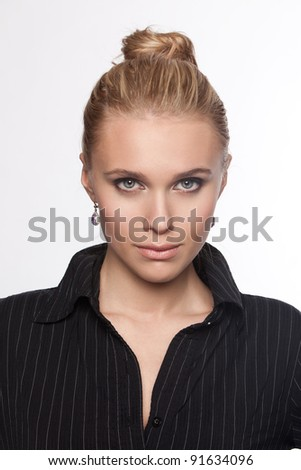 Beautiful blonde woman in a black blouse - stock photo