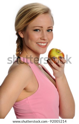 Beautiful blonde woman in excecise top holding an apple. Healthy living. - stock photo