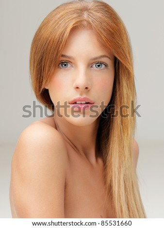 beautiful blonde woman looking over shoulder - stock photo