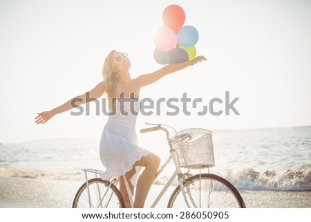 beautiful blonde woman on a sunny day at the beach - stock photo