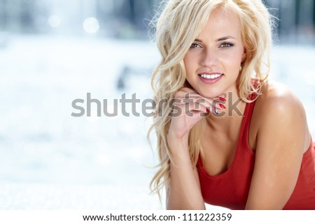 Beautiful blonde woman portrait - stock photo