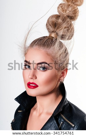 Beautiful blonde woman portrait with amazing hairstyle. Studio shoot