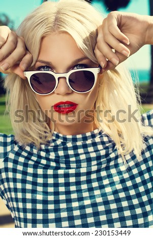beautiful blonde woman posing in fashionable sunglasses. Fashion photo - stock photo