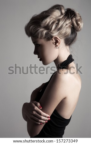 Beautiful Blonde Woman. Retro Fashion Image. - stock photo
