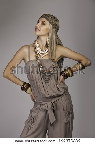 Beautiful blonde woman wearing African styled bohemian clothing - stock photo
