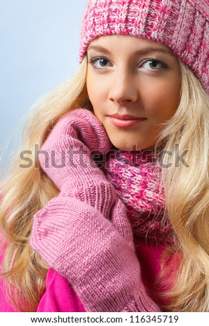 beautiful blonde woman wearing knitwear over blue - stock photo