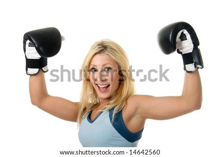 Beautiful blonde woman with black boxing gloves on a white background.