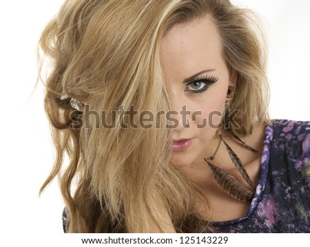 Beautiful blonde woman with hair covering one eye - stock photo