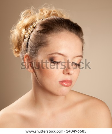 Beautiful blonde woman with hairstyle looking down - stock photo