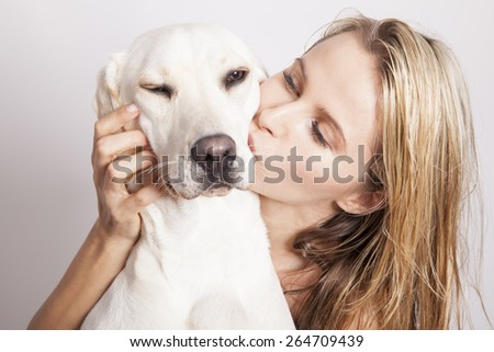 beautiful blonde woman with her dog, studio shot. horizontal - stock photo