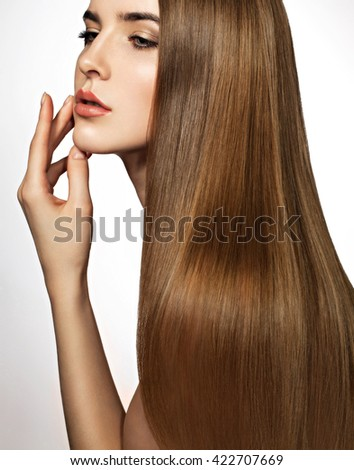 Beautiful blonde woman with long, healthy, straight and shiny hair. Hairstyle loose hair. Model girl with luxurious smooth straight hair. Hair cosmetics. White background. - stock photo