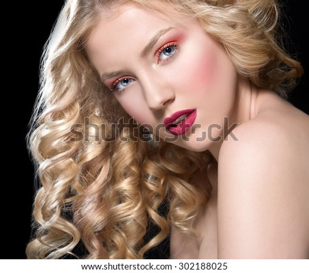 beautiful blonde woman with perfect curly hair. Woman with bright make up - stock photo