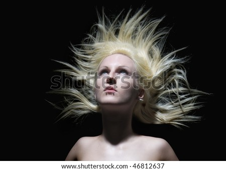 Beautiful blonde woman with piercings and crazy hair - stock photo