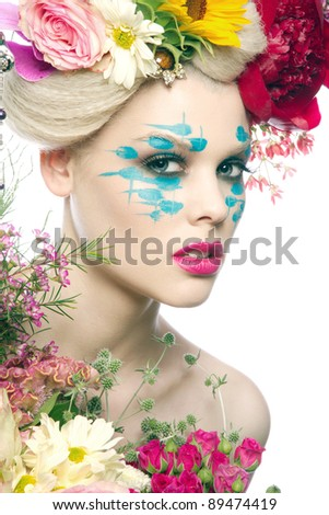 Beautiful blonde woman with professional make-up and flower headpiece