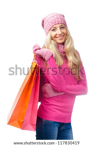 beautiful blonde woman with shopping bags over white - stock photo