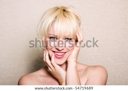 Beautiful blonde woman with smile - stock photo