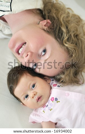 beautiful blonde young mother and cute baby - stock photo