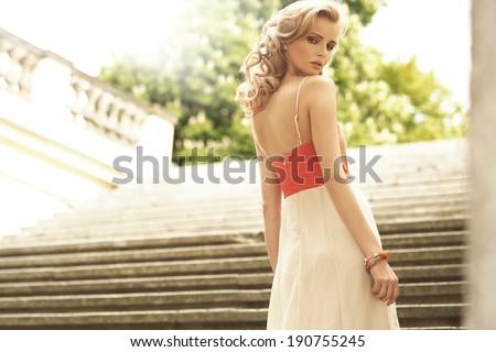 Beautiful blonde young woman - stock photo